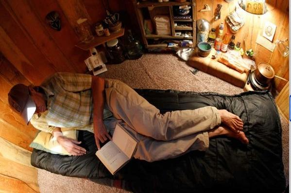 Former Advocate photographer Dan Price lounges in his tiny underground home in Oregon.