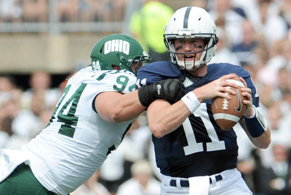 Ohio Bobcats defensive lineman Corey Hasting (94) pressures Penn State Nittany Lions quarterback Matthew McGloin (11) at Beaver Stadium in University Park on Saturday.