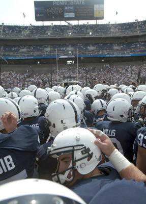 Players gather during warm-ups as Penn State Nittany Lions plays against the Ohio Bobcats at Beaver Stadium in University Park on Saturday.