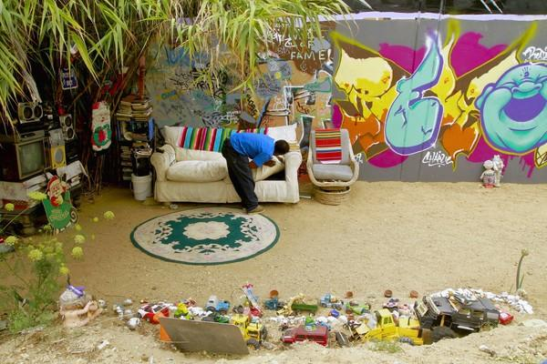 Charles Ray Walker at his brightly decorated Boyle Heights encampment in 2010.