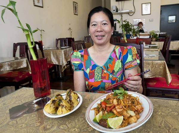 Jenny Lim is seated inside her new south Bethlehem restaurant 'Jenny's Kuaki' on Thursday.