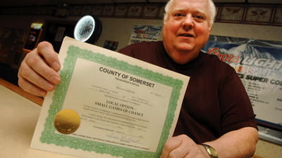 Secretary Fredric Rosemeyer sits with the Fraternal Order of Eagles small games of chance license. The certificate normally is posted in a display case near the bar.