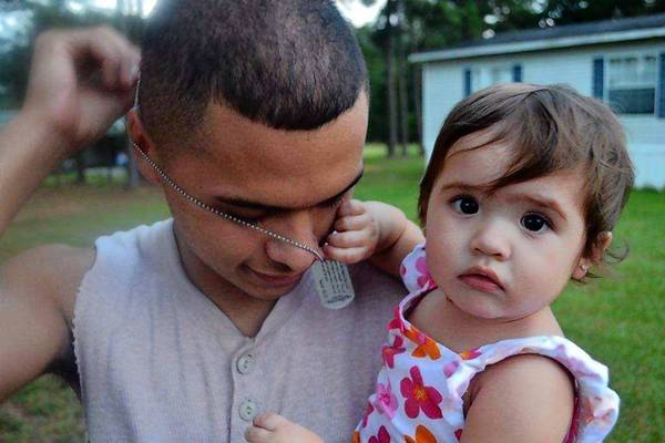 Jesus Martinez Jr., with his daughter, Camila, will turn 18 a month before the November election. He's not a fan of President Obama, but plans to vote for him anyway to speak for his family.