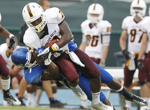 CNU Captains Terrell Fowler, left, stops the Salisbury Sea Gulls Nick Aloi at Pomoco Stadium in Newport News on Saturday.