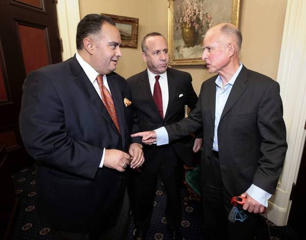 Gov. Jerry Brown, right, meets with Assembly Speaker John Perez and Senate leader Darrell Steinberg in Sacramento on Friday after the Legislature approved an overhaul of the workers' compensation system. Brown had publicly pressured lawmakers to pass that bill.