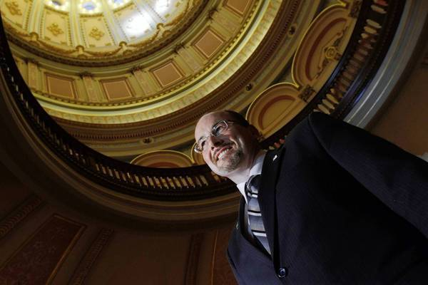 Republican Assemblyman Tim Donnelly poses for a portrait in the rotunda of the Capitol in Sacaramento. With little chance of affecting policy in a Legislature run by Democrats, the fiercely conservative Donnelly has made his Assembly desk a soapbox, testing fellow lawmakers' patience with scorched-earth rhetoric on his favorite subjects.