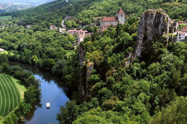 The village of Saint-Cirq Lapopie sits on a bluff above the Lot River in southwestern France.