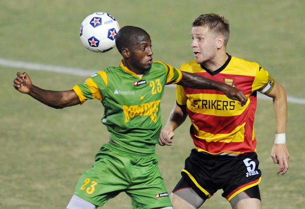 Fabrice Piqualt of Tampa Bay battles with Toni Stahl of the Fort Lauderdale Strikers in the first half at Lockhart Stadium.