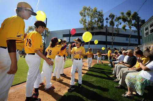 Connor O'Brien (3) of the Orange County Sun Devils walks down the line as his team is introduced during opening ceremonies for the newly built Sun Devil Field on Harbor Boulevard in Costa Mesa.