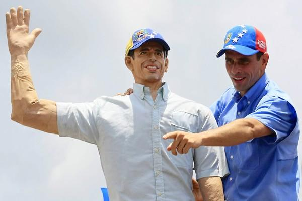 Venezuelan presidential candidate Henrique Capriles with a life-size replica at a campaign rally Sept. 1, 2012, in Miranda, Venezuela. Capriles is running against President Hugo Chavez in the country's Oct. 7 election.