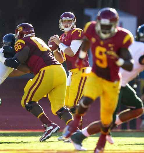 USC quarterback Matt Barkley watches receiver Marqise Lee run his pattern against Hawaii on Saturday at the Coliseum.