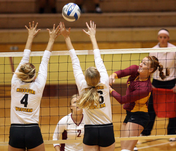 Northern State University's Jussy Tuscherer, right, hits the ball past the defense of Missouri Western State's Meredith McCormick, left, and Jessie Thorup, center, during Saturday's match in the Northern State/ Dacotah Bank Classic at Wachs Arena.