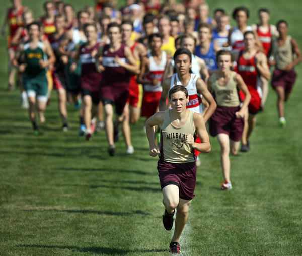 Milbank's Austin Berens leads the field shortly after the start of Saturday's 5,000-meter run at the 52nd annual Roe Granger/Dakota Silk Screen Cross Country Meet at the Moccasin Creek Soccer Complex.
