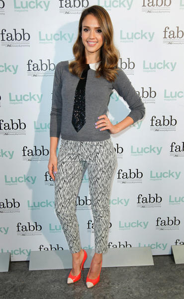 Jessica Alba in an Alice & Olivia sweater and Giuseppe Zanotti shoes.