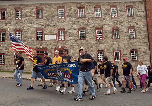 United Steelworkers members take the lead in the annual Steelworkers and Friends parade as they head onto Main Street in Bethlehem on Sunday.