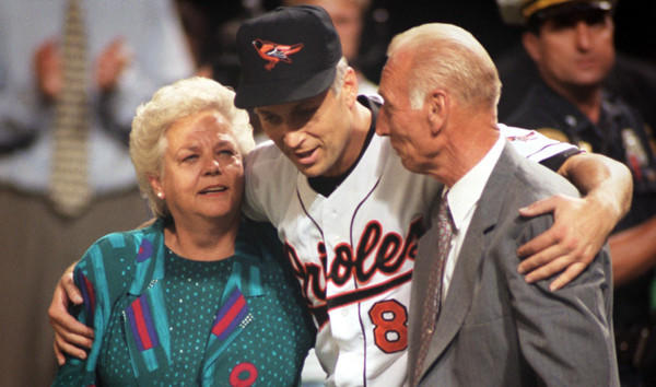 Cal Ripken Jr. celebrates with his parents, Vi and Cal Sr., after breaking Lou Gehrig's consecutive games record.