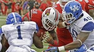 No. 25 Louisville coasts to 32-14 over rival Kentucky