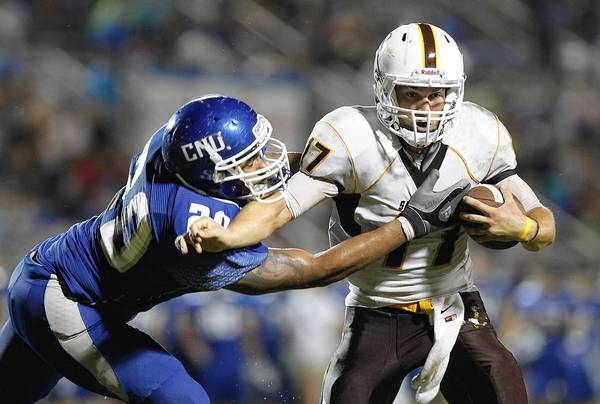 CNU's Justin Navarro, left, tackles Salisbury quarterback Dan Griffin at Pomoco Stadium in Newport News on Saturday.