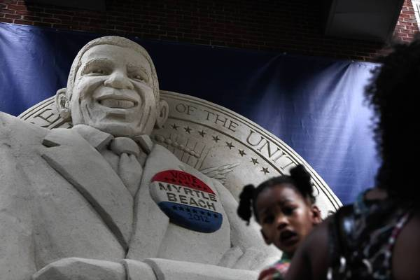 A promotional sand castle of President Barack Obama graces a street in downtown Charlotte.