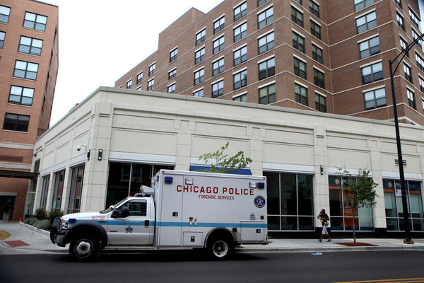 A Chicago Police forensic unit truck sits outside a building on the 1000 block of West Montrose Avenue, where authorities say a homicide occured early Sunday morning.