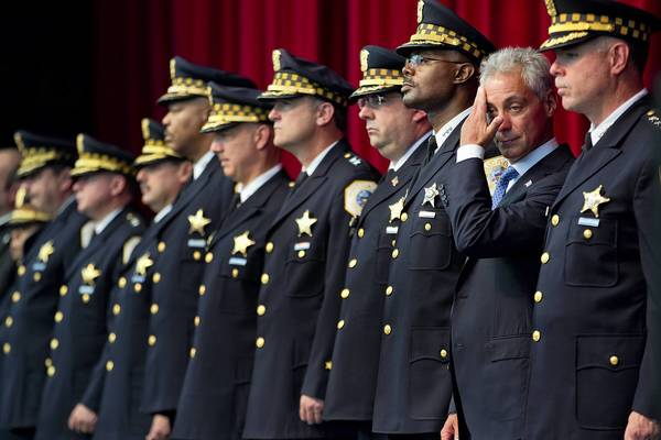 Mayor Rahm Emanuel attends a police graduation ceremony on Friday at Navy Pier. Later in the day, at a news conference on the South Side, the mayor and police Superintendent Garry McCarthy, right, said they were expanding an initiative that would pour police resources into crime-ridden neighborhoods.