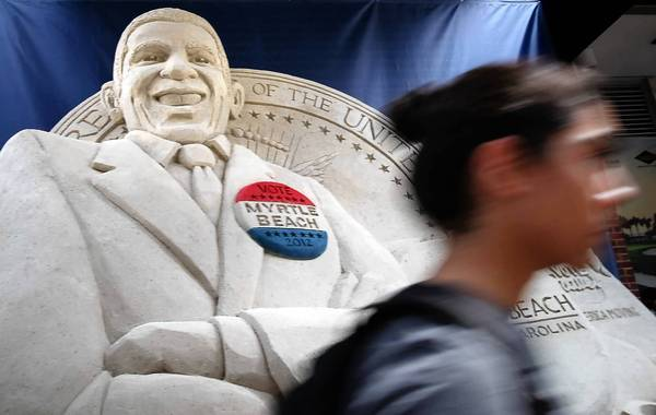 A sand sculpture of President Obama is on dislay near the site of this week's Democratic National Convention in Charlotte, N.C.