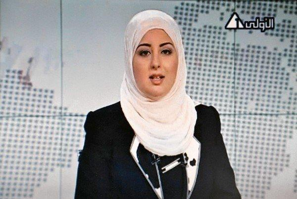 Fatma Nabil is the first presenter to appear on Egyptian state television in a head scarf.