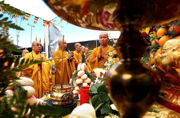 Monks chant during Le Vu Lan, a Buddhist celebration of mothers, at Hue Quang Temple in Santa Ana.