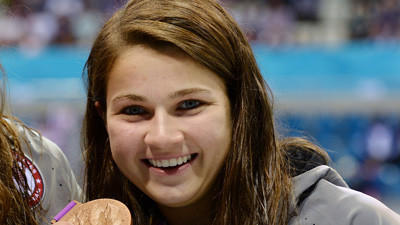 NDP swimmer Becca Meyers shows off her bronze medal at the London Paralympics