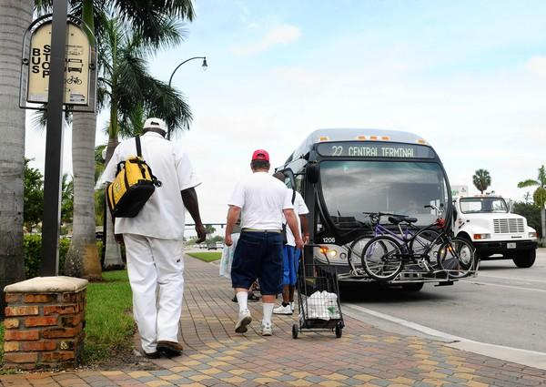 Broward County bus riders get on a bus from a bus stop just East of 441 on Broward Blvd. on Route 22 Friday morning. Broward County's pushing bus ridership to non-traditional riders here -- people who have cars -- urging them to take a bus, with wifi and a/c -- to work.