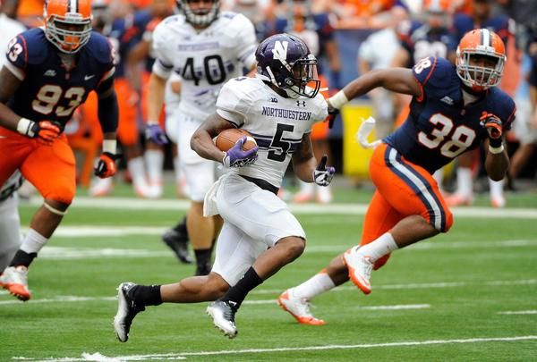 NU's Venric Mark is pursued by Syracuse defenders during Saturday's NU victory.