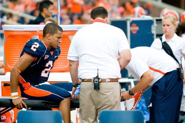 Illini quarterback Nathan Scheelhaase is tended to by trainers during the third quarter against Western Michigan.