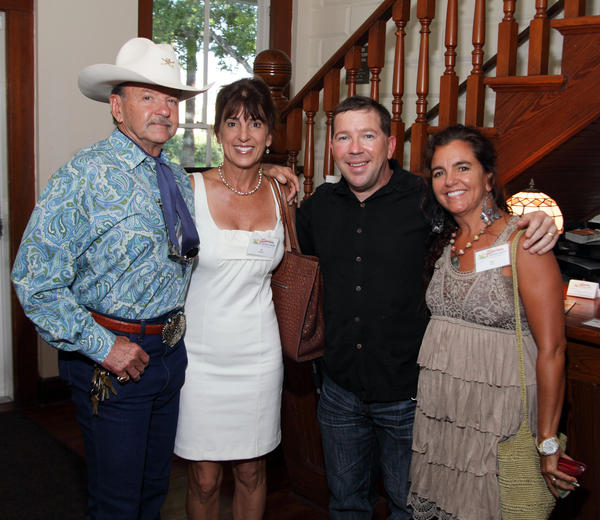 Ron Bergeron, left, Ali Waldman, Lonnie Bergeron and Lisa Hohara at a recent reception, where the Fort Lauderdale Historical Society presented Rob Bergeron with the H. Wayne Huizenga Centennial Tree Alligator and Proclamation of the City of Fort Lauderdale.