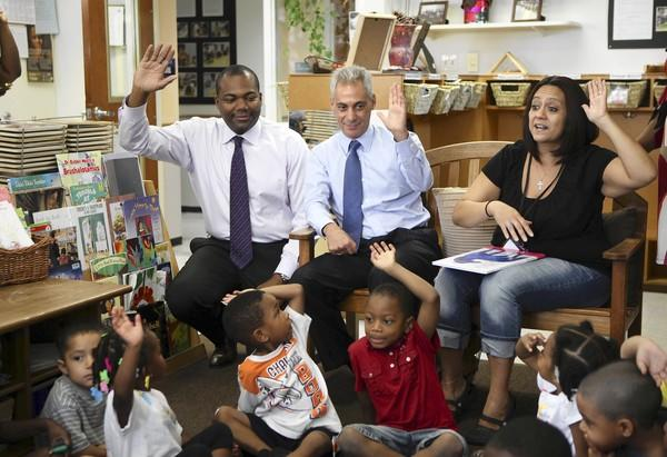 Mayor Rahm Emanuel, center, and Chicago Public Schools CEO Jean-Claude Brizard visited a pre-K class at the Nia Family Center last month to announce expansion of early childhood education opportunities for Chicago children.