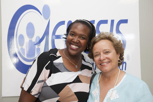 DeAnna Warren, left, and Debra Kerr at a reception where Genesis Community Health recently celebrated the progress and growth of the organization and its new status as a public-private partnership.