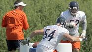The image of Brian Urlacher lunging forward in a helmet and shoulders pads was something the rest of the Bears sorely missed.