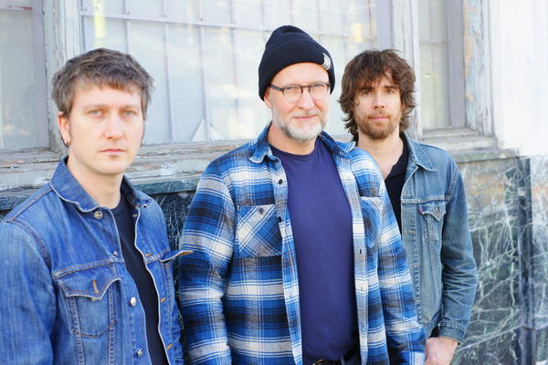 Bob Mould, center, with Jason Narducy, left, and Jon Wurster.