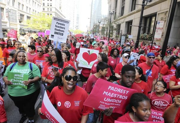 Supporters of the Chicago Teachers Union march outside City Hall on Monday to show support for negotiations with the city. Talks also were held on Labor Day.