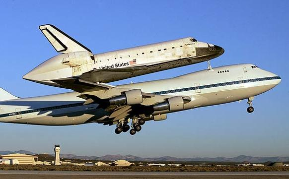 The space shuttle Endeavour takes off from Edwards Air Force Base piggybacked to a modified 747 on its way back to the Kennedy Space Center in Florida.