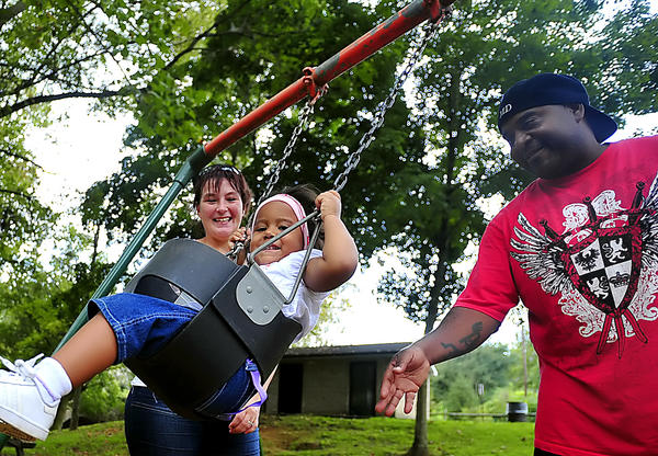 Tina and David Dorman of Hagerstown swing their daughter, Nevaeh, 2, on Labor Day at Devil's Backbone Park near Boonsboro.