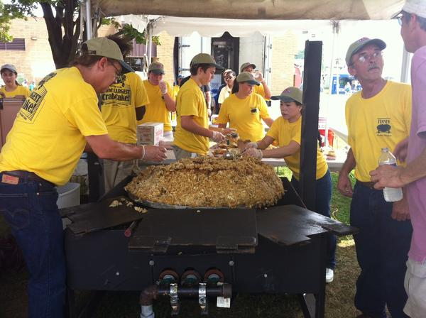 People serve up the world's largest crab cake after setting the record at Saturday's Maryland State Fair.