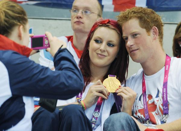 Britain's Prince Harry poses for photgraphs with Great Britain swimming gold medalist Jessica-Jane Applegate at the Aquatics Centre during the London 2012 Paralympic Games September 4 2012. REUTERS/Stefan Rousseau/POOL