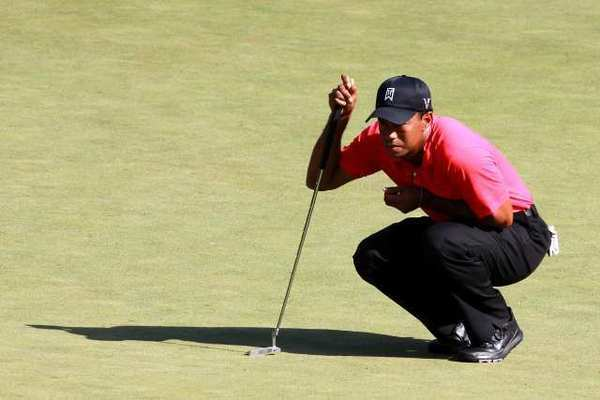 Tiger Woods lines up a putt during the final round of the Deutsche Bank Championship.