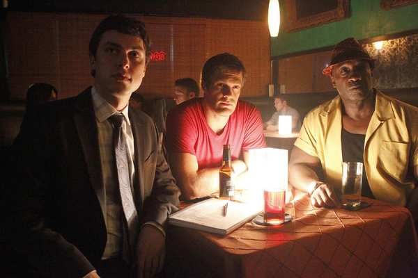 "Walter (Geoff Stults, center), Leo (Michael Clarke Duncan, right) and Dr. Lance Sweets (John Francis Daley) follow a lead to a jazz bar in the 2011 ""Bullets"" episode of the television series ""The Finder."""