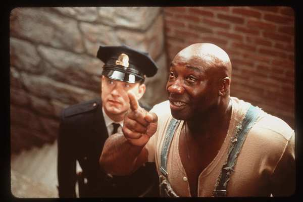"Tom Hanks and Michael Clarke Duncan in the 1999 drama ""The Green Mile."""