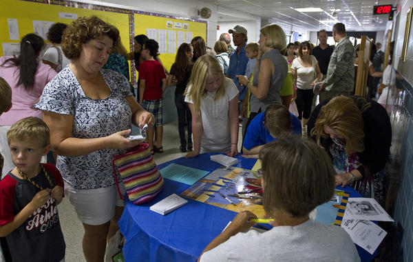 Parents sign up for the PTA inside Dare Elementary School early Tuesday.