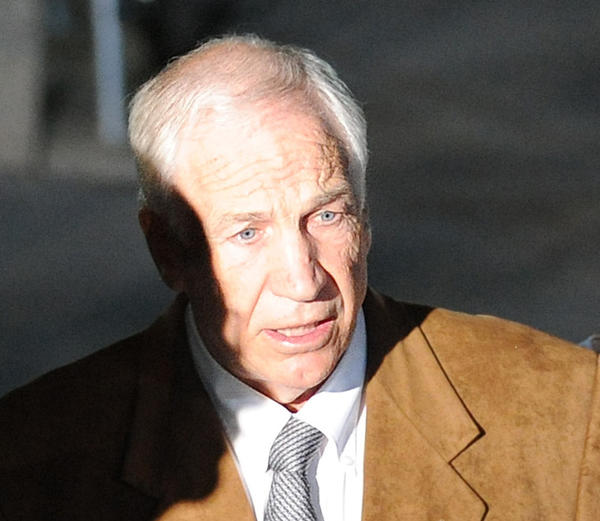 Jerry Sandusky leaves in handcuffs after his trial at the Centre County Courthouse in Bellefonte on Friday.