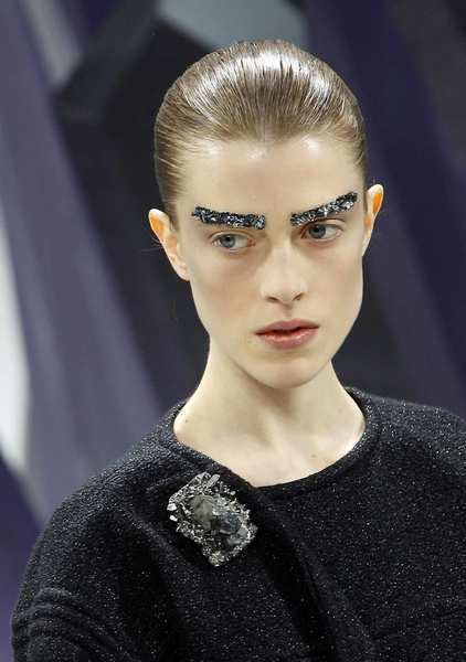 A model with bejeweled brows in a look from Chanel during Paris Fashion Week.
