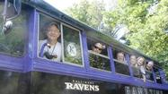 Catonsville man tailgates at Ravens games in purple bus and ambulance