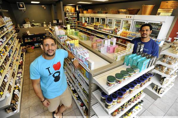 Curtis (left) and Phil Price, and their mother, Monika, have reopened their Laurel Health Food store at 358 Main St. The family business was founded 42 years ago by the Price's grandparents, and opened in Old Georgetown Alley at Laurel Shopping Center.